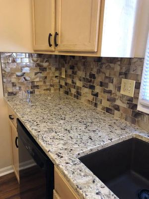 Image of remodeled kitchen countertops with marble finish