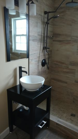 Image of Modern Sink and Large Shower Head