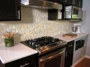 Image of remodeled kitchen area with colored brick walls