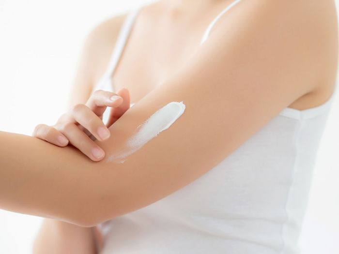 image of someone applying shea butter and kokum butter to their arm