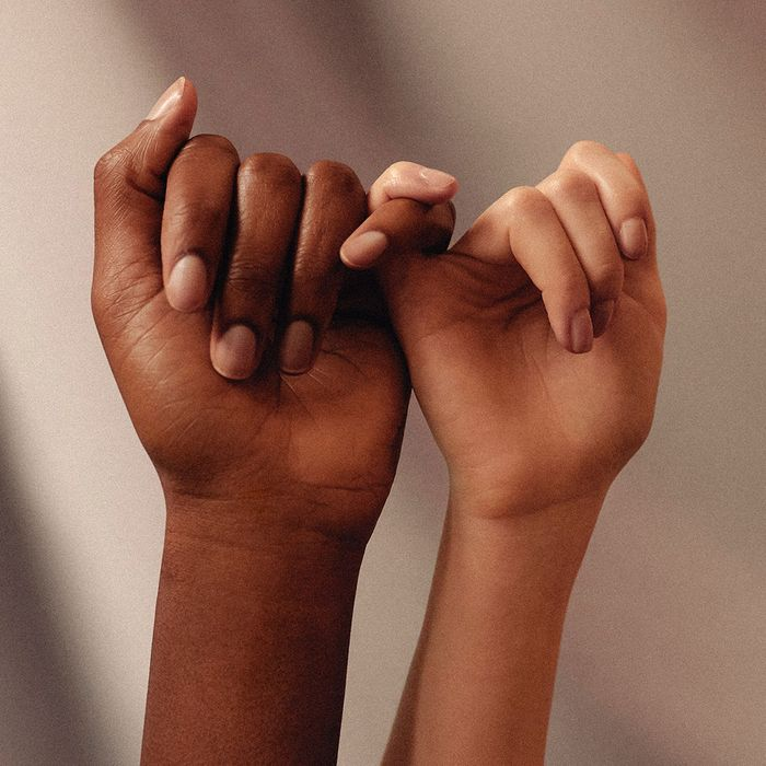 image of two people's hands linking pinkies