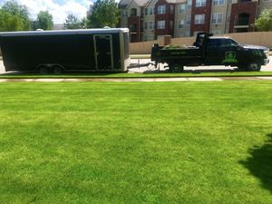 Company truck and some green grass.JPG