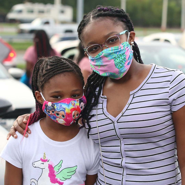 two youths wearing masks in kids ministry