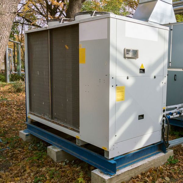 A large commercial air conditioning unit outside.