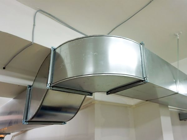 Ventilation ducts running along a ceiling.