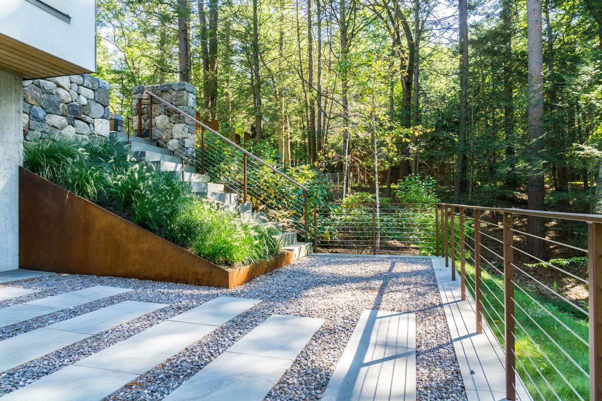 ANDLC-Lincoln Corten Planter Wall and back patio 4.jpg