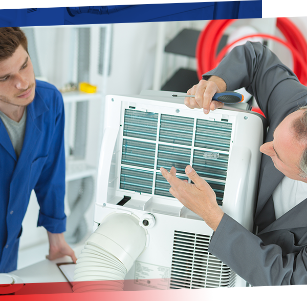 Image of two technicians analyzing an HVAC main unit