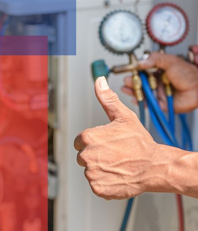 Man checking furnace giving a thumbs up