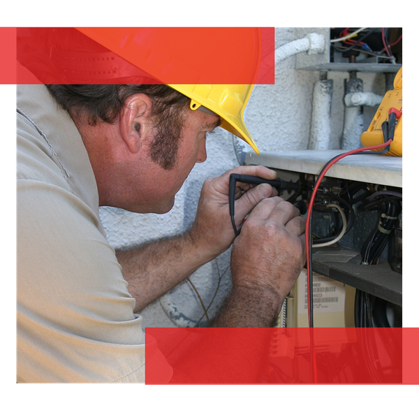 Image of an HVAC technician performing repairs.