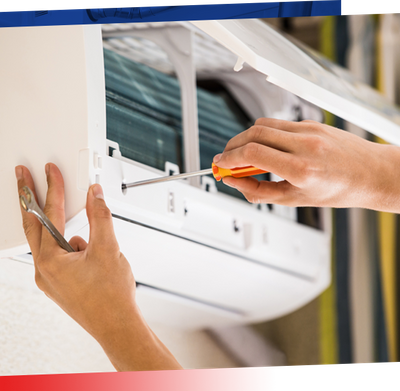 Image of hands working on an AC window unit
