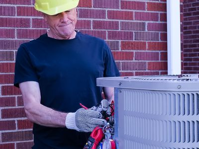HVAC Technician diagnoses outdoor air conditioning condenser with tools and gauges.