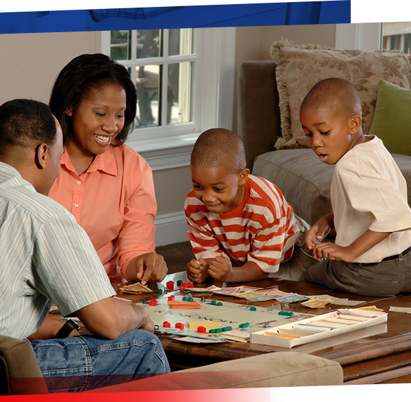 Image of family playing Monopoly