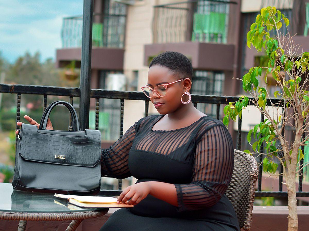 A Black woman sitting on a patio.