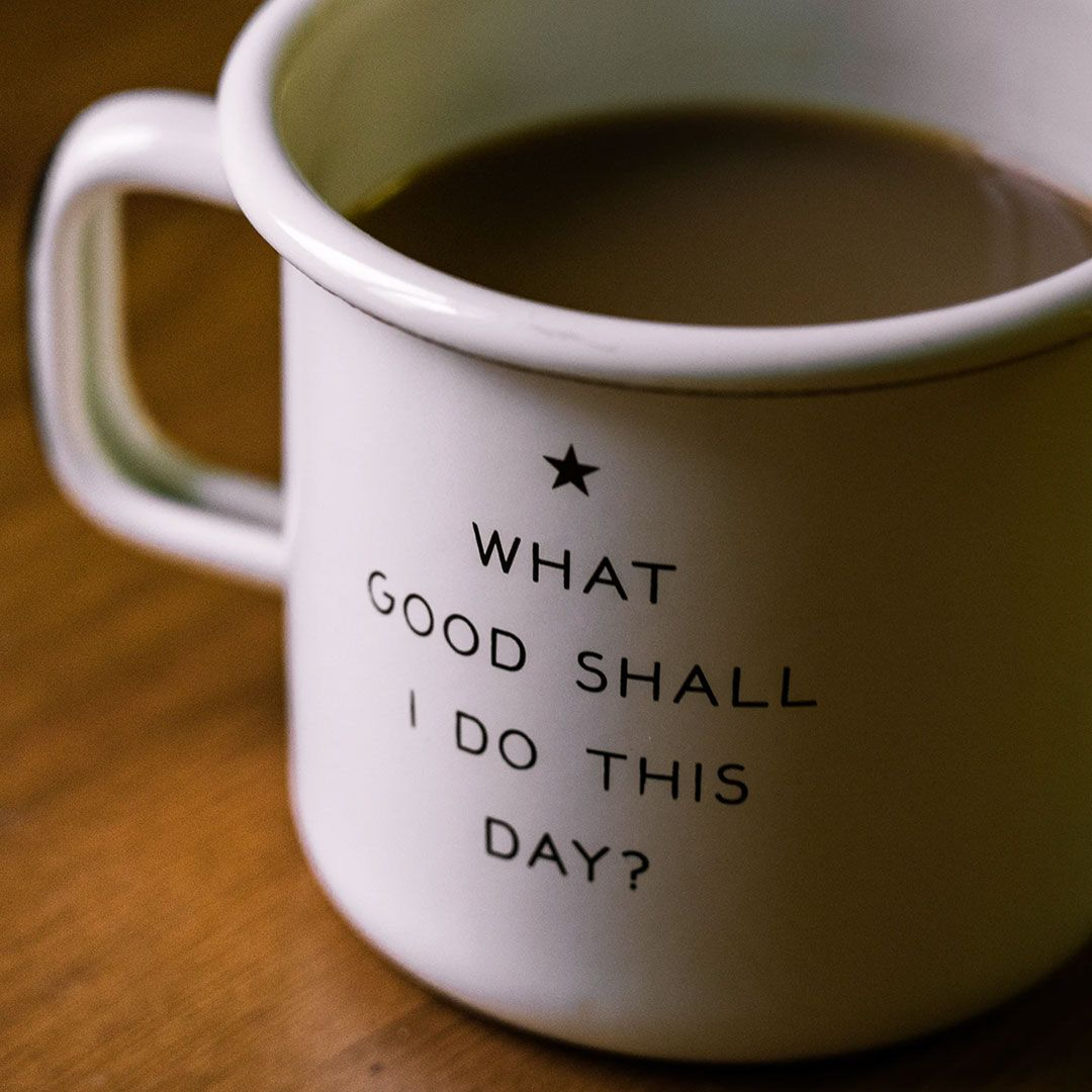 An image of a coffee cup with a saying on it.