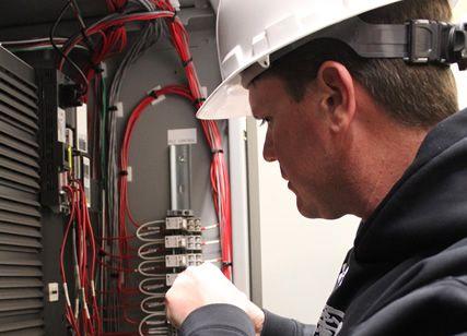 electrician adjusting wires