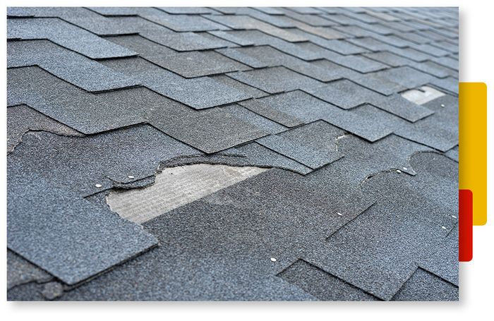 Image of a residential roof during a storm.