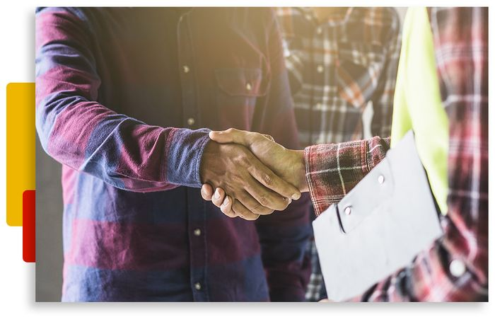 Image of a customer shaking hands with an inspector