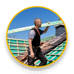 man carrying lumber on roof