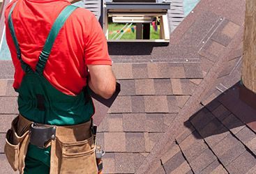 Image of a roofing contractor performing roof repair.