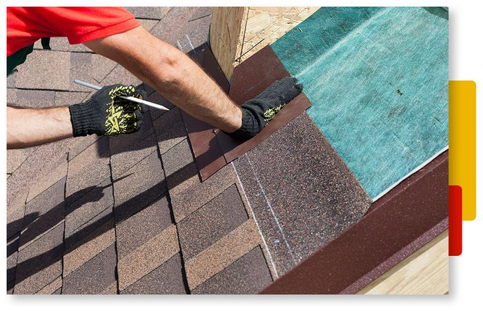 Image of a team of roofers installing a new roof.