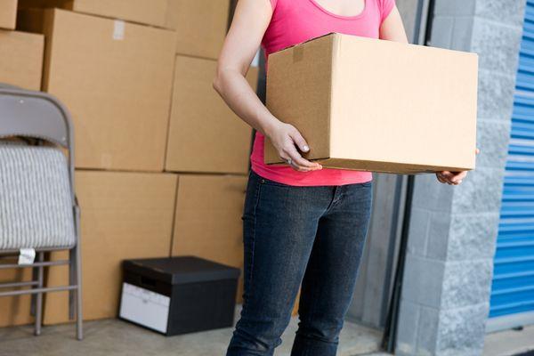 closeup woman carrying box
