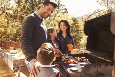 happy family outdoors grilling